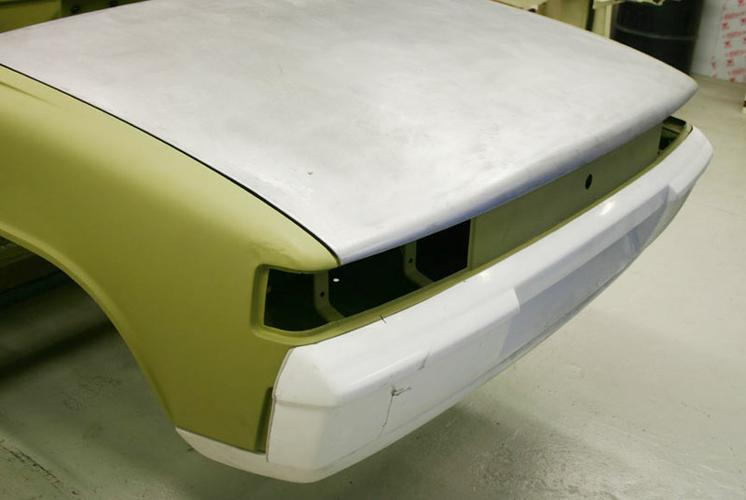 THIS SHOWS THE FITMENT OF THE BUMPER COVER - REAR - 914 6 GT TYPE - INCLUDES MOUNTING BRACKET SET - COMPOSITE *REPRODUCTION 914-6 GT -PART NUMBER BOD 914GTRB  - ALONG WITH THE LOWER VALANCE - 914 6 - NON FLARED - REPRODUCTION OF ORIGINAL 914 6 - DEEP TYPE FOR ADDITIONAL MUFFLER CLEARANCE -                   PART NUMBER   BOD 914-106