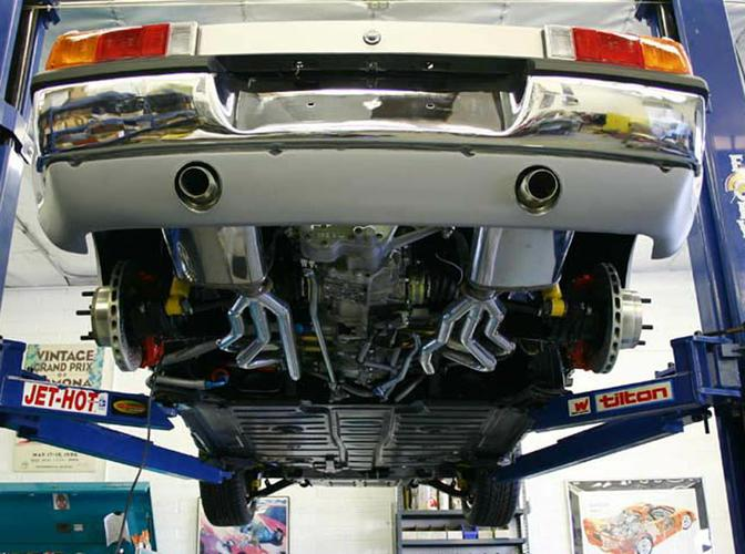 Rear bottom shot of 964 engine, 915 WEVO transaxle, The WEVO 915 Side Shift kit is a new approach to an old problem. A solution long overdue for the many mid engine Porsche cars that can choose from the 901 or 915 series transmissions. With most modern 6 cylinder mid engine cars capable of developing torque output above the practical limit of the 901 series transmission, the 915 has become increasingly preferred for the larger gears, crown wheel and pinion and drive flanges. 