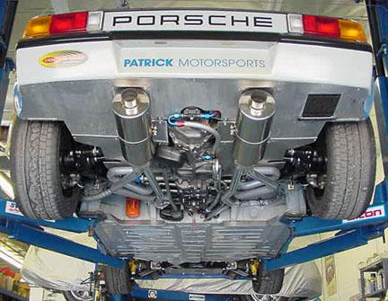 PICTURED FROM THE REAR IS OUR DUAL SPORT EXHAUST SYSTEM - PORSCHE 914 6 - TWIN STAINLESS STEEL MUFFLER SYSTEM WITH POLISHED TIPS - 2.25 INCH (57 MM) O.D. IN / OUT - 914 6 REAR LOWER VALANCE REQUIRES TIP EXIT HOLES  PART NUMBER PMP9146DMS