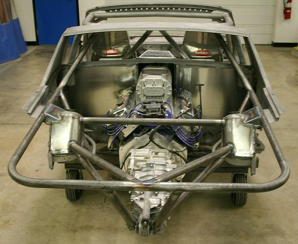 "With the small block Chevy and G50/52 trans installed in the frame you can see that there is really not much left of the stock 914 in the rear. We did use the 914 rear Suspension. Our  Rear Coil Over System - Porsche 914 '70-'76 – Sport / Race - Includes : 2) BILSTEIN rear sport height adjustable shocks, EIBACH 2.50 inch I.D. spring set (available in 25 lbs increments from 150 lbs to 400 lbs), upper spring hat set, 2) lower spring perch sets ""fully adjustable"" – For street use setup we recommend (175-225 lbs spring set) – For full racecar setup we recommend (275- 325 lbs spring set). The system allows infinite ride height adjustability and corner weight balance setup. Part # SUS 914 RCKIT and PMP914-RTRAKT Fit all 914 chassis-includes 914 certified reconditioned trailing arm set with reconditioned and polished pivot shafts, plated bearing retainer plates, and box reinforcing kits, we added ""D"" hooks at the rear for towing and DYNO tie down points, then finished them in black powder coating. Now is the time to add the Delrin bushings part #SUSRDCABUSH, NEW WHEEL BEARINGS PART # DRI 99905303500 and 5 bolt hubs Part #DRI 99931106533for your wheel and tire swap. Also our rear toe adjusting kit Part # PMP914RTOEKIT