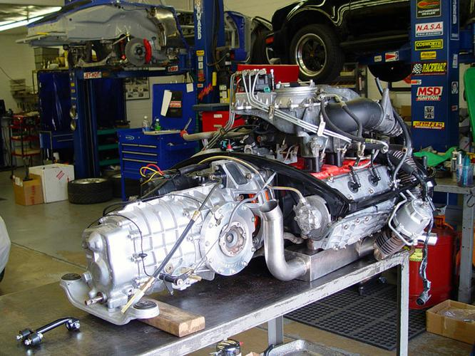 This picture shows the Porsche G50 Transaxle converted to Short Bell Housing Configuration - RSR Spec with our Exclusive Billet Side Cover for the  G50 type trans axles found in the PORSCHE 911 '87-'98 manufactured from T 6061 BILLET ALUMINUM includes new case stud set.
