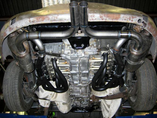 This is a great shot of the 3.6 and 915 trans installed with our 911 headers and custom made duel muffler system. On the ground you will see very little on the system, making it very hard to tell this is anything more than a beautifully restored 356 until you get a better look at the back of the car when it blows your door off!!!