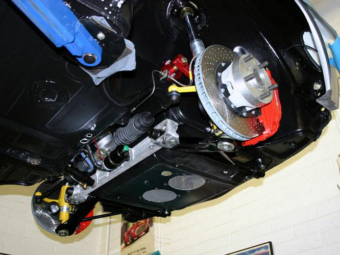 THIS SHOT SHOWS OUR FRONT SUSPENSION AND BRAKE UPGRADE, STARTING WITH A 911 DONOR SUPENSION, STEERING RACK AND BRAKE SYSTEM. IT'S THEN IMPROVED WITH OUR FRONT CONTROL ARM SET  FOR PORSCHE 911 / 914 - CONVERTED TO EARLY ANTI-SWAY BAR TYPE MOUNTS / D-LOOPS REMOVED WITH U-TABS INSTALLED - CERTIFED USED SET RECONDITIONED, MODIFIED AND POWDERCOATED BLACK - 911 SPLINED - ALSO INCLUDES RECODITIONED CARRIER BRACKETS - SOLD AS SET -  PART NUMBER PMP914-911-FCAKT 