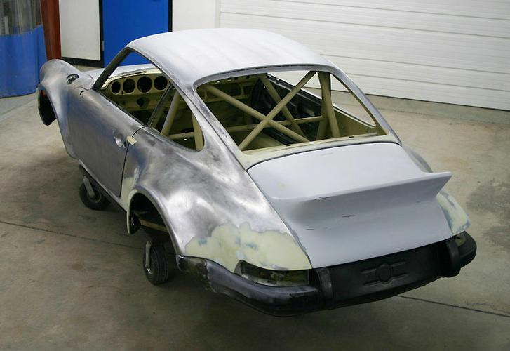 78-to-73-RSR-TT-body-bare-getting-fitted--rear