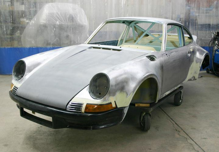 78-to-73-RSR-TT-body-bare-getting-fitted-L-front