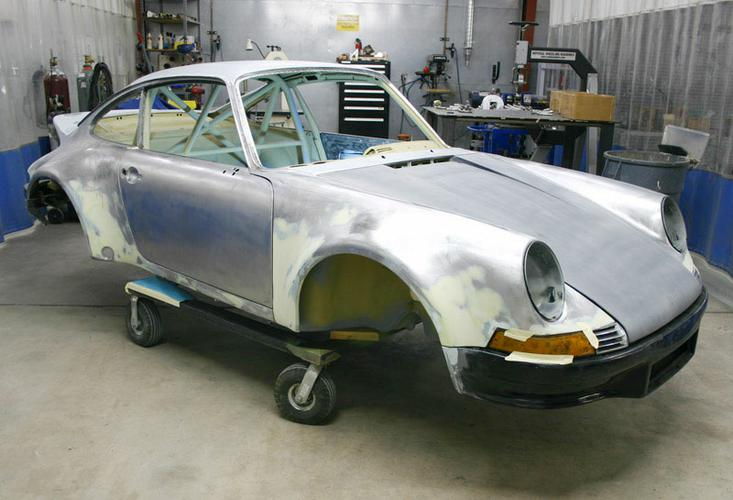 78-to-73-RSR-TT-body-bare-getting-fitted-R-front