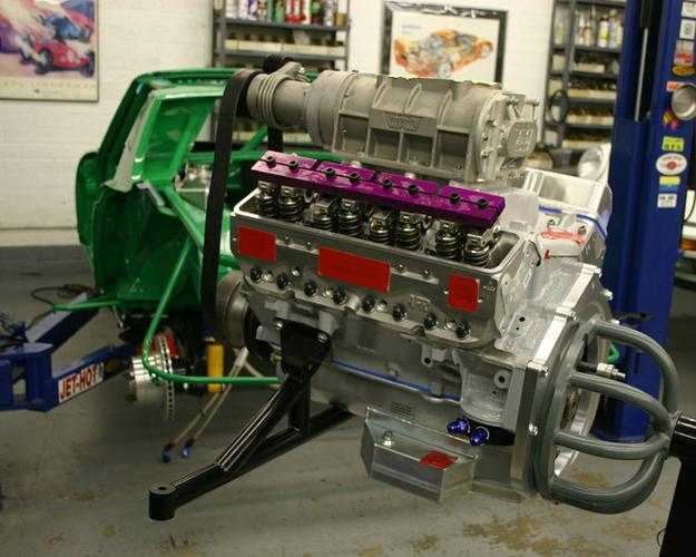 Here is the power plant ready to be mounted in the frame. This is a small block Chevy with Air Flow research aluminum cylinder heads, roller rockers and stud girdles. the super charger and not shown.